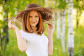 Portrait of young beautiful woman wearing hat — Stock Photo
