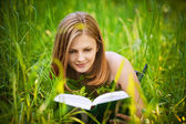 Portrait of young woman reading a book — Stock Photo