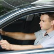 Portrait of young man driving car — Stock Photo