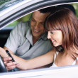 Young couple looking to mobile phone — Stock Photo