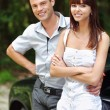 Royalty-Free Stock Photo: Two young smiling near car