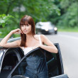 Young attractive brunette woman near car — Stock Photo