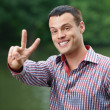 "Young man showing ""peace"" sign — Stock Photo #6279606"