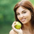 Beautiful smiling woman holding green apple — Stock Photo #6279646