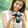 Portrait of young beautiful brunette woman holding photocamera — Stock Photo #6279652