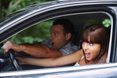 Young couple driving car — Stock Photo