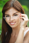 Portrait of young woman wearing eyeglasses — Stock Photo