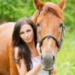 Portrait of young beautiful woman with horse — Stock Photo