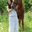 Young beautiful woman with horse — Stock Photo #6304294