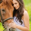 Portrait of beautiful brunette woman with horse - Photo