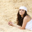 Stock Photo: Portrait of woman lying in sawdust
