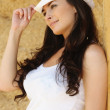 Portrait of attractive woman wearing white cap — Stock Photo