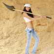 Young smiling woman holding spade — Stock Photo