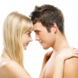 Young couple looking at each other against white background — Stock Photo