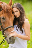 Portrait of beautiful brunette woman with horse — Stock Photo