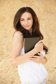 Portrait of brunette woman holding book — Stock Photo