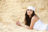 Portrait of woman lying in sawdust — Stock Photo