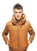 Portrait of young attractive man wearing keather jacket — Stock Photo
