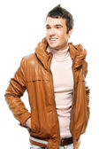 Portrait of young man wearing leather jacket — Stock Photo