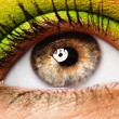 Colourfully painted eye - Stockfoto