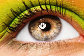 Colourfully painted eye — Stock Photo
