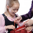 Little joyful girl receiving gift - Stock Photo