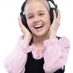 Portrait of little girl listening to music — Stock Photo