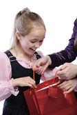 Little joyful girl receiving gift — Stock Photo