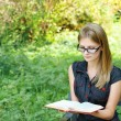 Young fair-haired woman reading book — Stock Photo