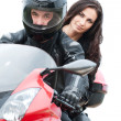 Young couple driving motorbike - Photo