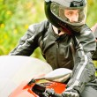Stock Photo: Portrait of young man driving motorcycle