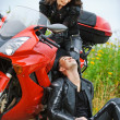 Young couple having rest at motorbike - Stock Photo