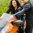 Stock Photo: Young couple with motorbike