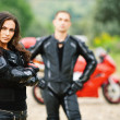 Two young against red motorbike - Stock Photo