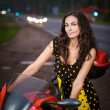 Portrait of young woman wearing dress standing near motorbike — Stock Photo #6458003