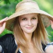 Portrait of young woman wearing straw hat — Stock Photo #6458063