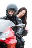 Young couple driving motorbike — Stockfoto