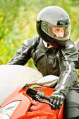 Portrait of young man driving motorcycle — Stock Photo