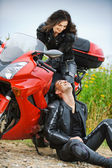 Young couple having rest at motorbike — Stock Photo