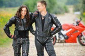 Two young against motorbike — Stock Photo