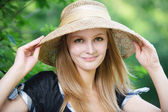 Portrait of young woman wearing straw hat — Stock Photo