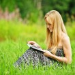Young blonde woman reading book — Stock Photo