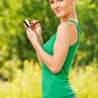 Portrait of pretty woman working with mobile phone - Stock Photo