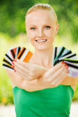 Portrait of woman holding colourful cards — Stock Photo