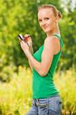 Portrait of pretty woman working with mobile phone — Stock Photo