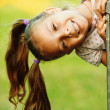Portrait of little pretty girl playing at summer green park — Stock Photo #6536986