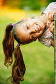 Portrait of little pretty girl playing at summer green park — Foto de Stock