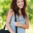 Brunette schoolgirl wearing big bag — Stock Photo