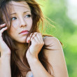 Portrait of troubled brunette girl - Stock Photo
