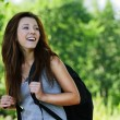 Pretty laughing girl wearing backpack — Stock Photo